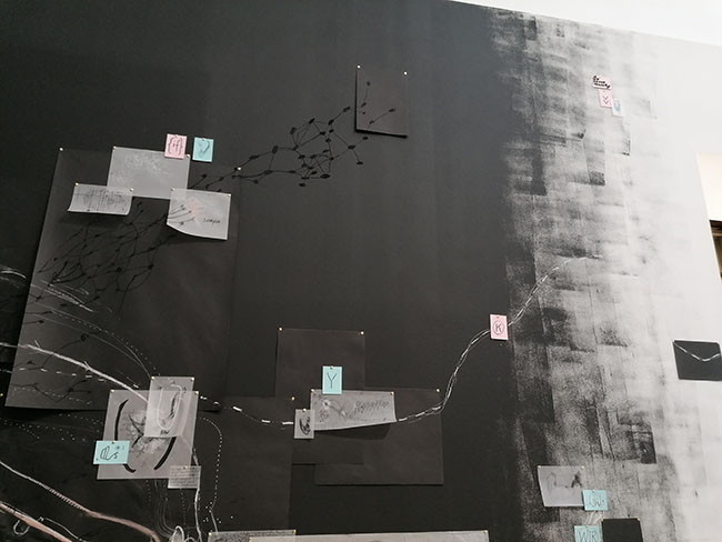Nikolaus Gansterer, Following the Fold, 2019, drawings in various dimensions pinned on a black wall, approx. 600 x 300 cm, installation view, Talbot Rice Gallery, Edinburgh