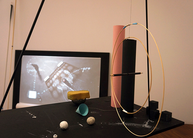 Nikolaus Gansterer, Transpositionsmodell II (Thinking<>Feeling<>Drawing<>Knowing), 2015, table, drawings, objects, video loop; installation view at the exhibition: Drawing Now, Albertina Museum, Vienna, Austria.