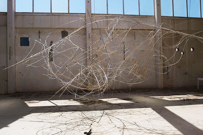 Nikolaus Gansterer, Sympoiesis Obersatory, 2019, site specific installation with found materials, mirrors,  bamboo, wood, wire, sound, video, 14th Sharjah Biennial, Ice Factory, Kalba, UAE