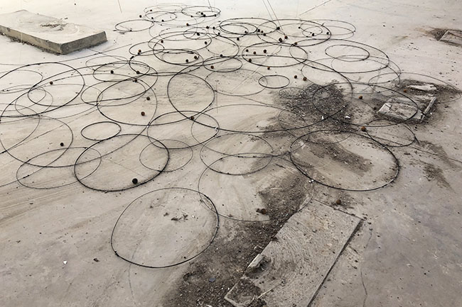 Nikolaus Gansterer, Sympoiesis Obersatory, 2019, floor drawing at site specific installation with found materials, mirrors, bamboo, wood, wire, sound, video, 14th Sharjah Biennial, Ice Factory, Kalba, UAE